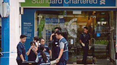 Lelaki rompak bank guna sekeping kertas di Singapura