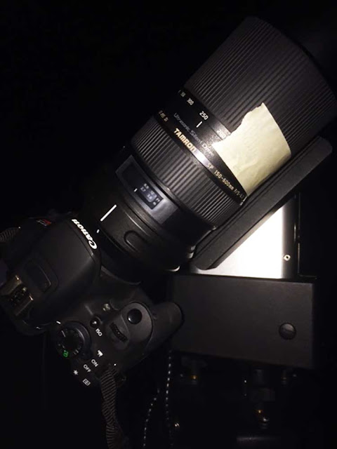 Astronomer uses masking tape to lock the lens setting in place
