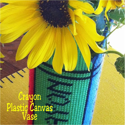 Go back to school in style with this easy crayon box plastic canvas vase.  This free pattern can be stitched up by even the beginner and decorate your home or classroom.  #backtoschool #vase #plasticcanvas #pattern #crayon #diypartymomblog
