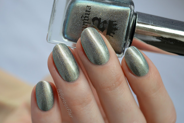 indie nail polish metallic gold shimmer natural light