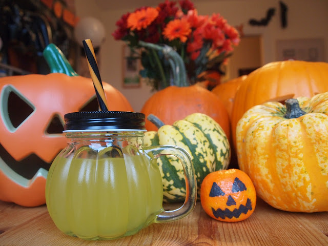 Glass pumpkin drinking jars with black and orange stripe straw from Party Pieces