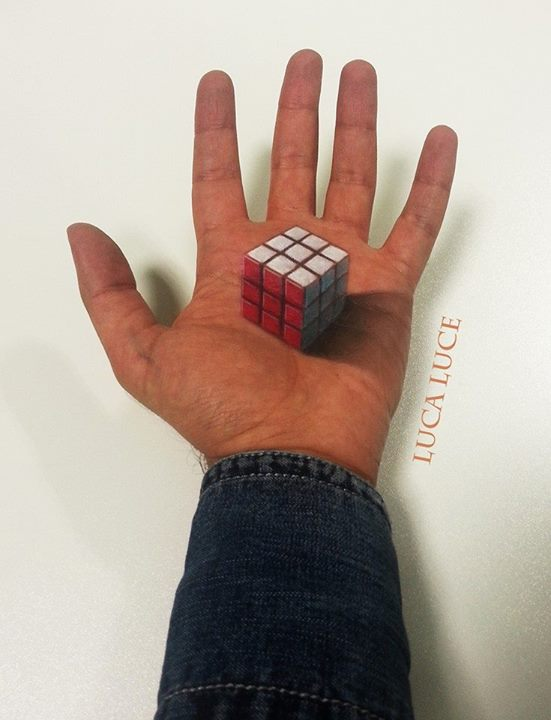 15-Rubik-s-Cube-Luca-Luce-Body-Painting-with-3D-Hand-Drawings-www-designstack-co
