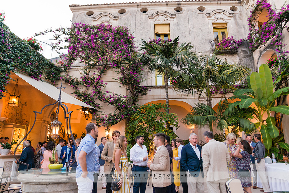 Guests during cocktail hour in Palazzo Murat courtyard