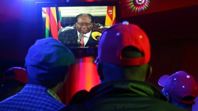 Zimbabwe's President Robert Mugabe defies own party, refuses to resign
