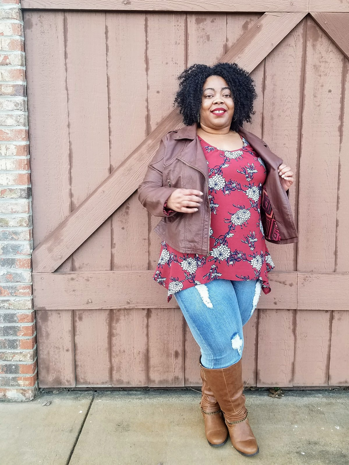 Floral print, ripped jeans, tall boots, natural hair, red lips, thick thighs, curvy blogger