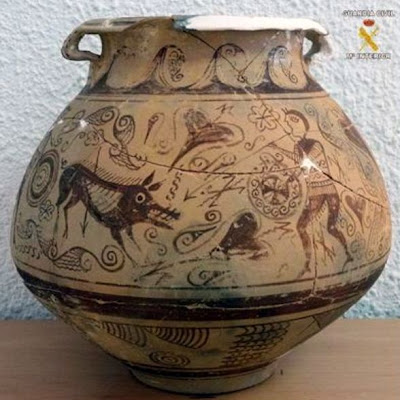 Spanish police seize ancient plundered vase from an antique shop