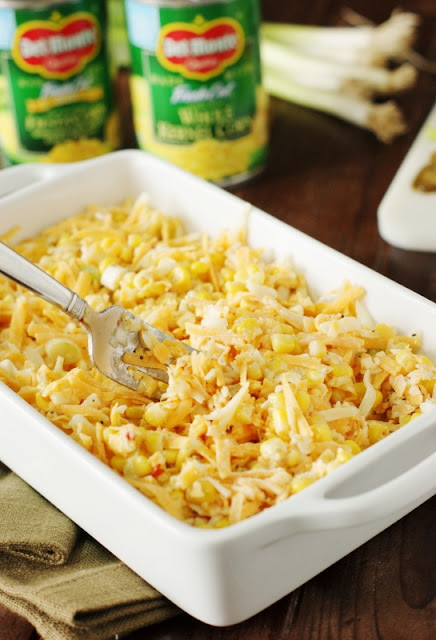 Fiesta Cheddar Corn Casserole ~ Ready for the oven in just 10 minutes, this easy creamy corn goodness adds just the right kick to any meal!  It truly couldn't be any easier to prepare.   www.thekitchenismyplayground.com