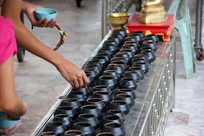 Offerings in Viharn Phra Mongkol Bophit - Ayutthaya Thailand