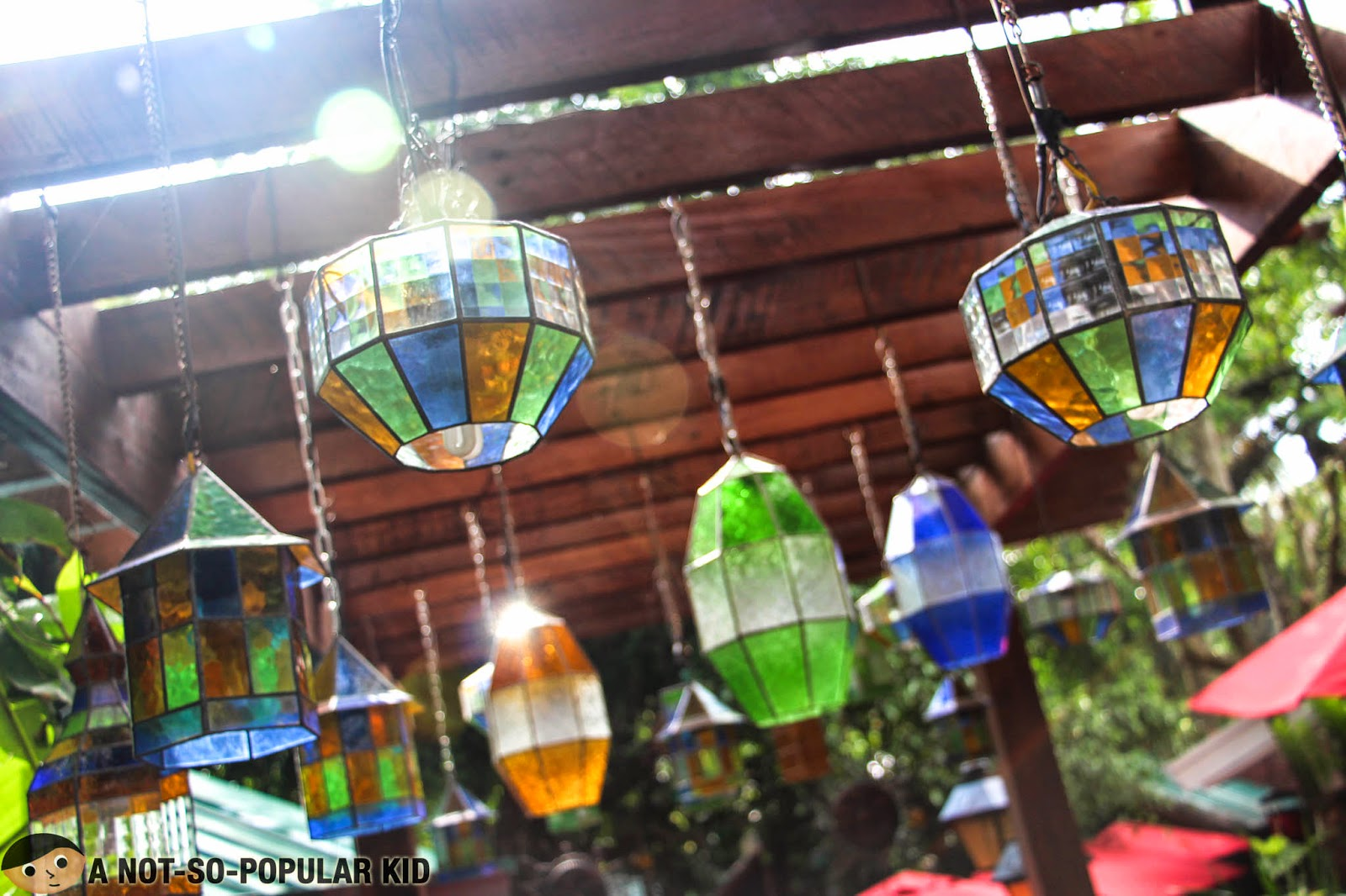 Colorful ceiling lamps in the garden like restaurant proper of Bag of Beans