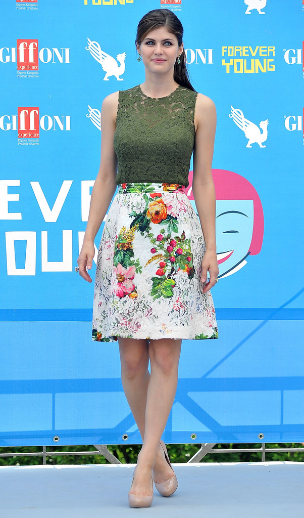 Alexandra Daddario wears a Dolce & Gabbana lace look and Miu Miu pumps.