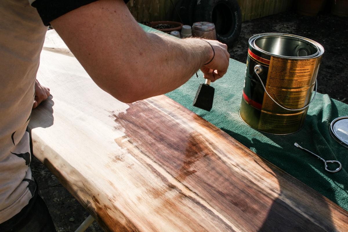 applying polyurethane to a live edge wood slab coffee table
