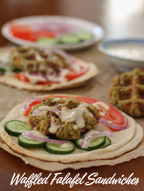 Food Lust People Love: Waffled falafel sandwiches are made by cooking your homemade falafel mix in a lightly oiled waffle iron which gets the falafels crispy outside and fluffy inside without frying. Stuff them in flatbread, drizzled with tahini sauce.