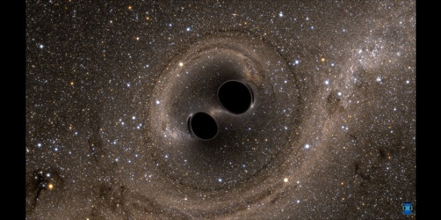 The collision of two black holes holes—a tremendously powerful event detected for the first time ever by the Laser Interferometer Gravitational-Wave Observatory, or LIGO—is seen in this still from a computer simulation. LIGO detected gravitational waves, or ripples in space and time generated as the black holes spiraled in toward each other, collided, and merged. This simulation shows how the merger would appear to our eyes if we could somehow travel in a spaceship for a closer look. It was created by solving equations from Albert Einstein's general theory of relativity using the LIGO data. Image Credit: SXS, the Simulating eXtreme Spacetimes (SXS) project (http://www.black-holes.org)