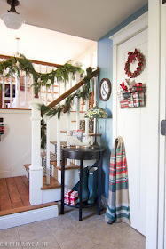 Fresh garland used to decorate entryway in split level home for Christmas