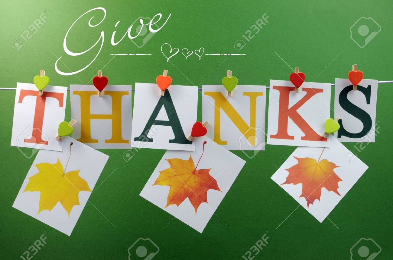give-thanks-message-spelling-in-letters-hanging-from-pegs-on-a-line-for-thanksgiving-greeting