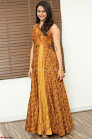 Rakul Preet Singh smiling Beautyin Brown Deep neck Sleeveless Gown at her interview 2.8.17 ~  Exclusive Celebrities Galleries 010.JPG