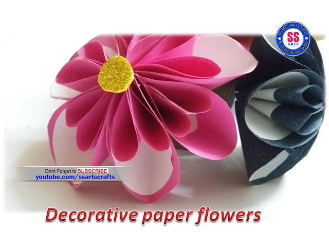Here is paper crafts,how to make paper flowers,how to make paper wall hangings,how to make paper wall decor,paper butterfly making,how to make paper innovative flowers,party decorations,festival room decorations,
