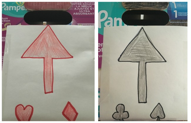 5-minute-games-for-toddlers-posting-cards-black-and-red-arrows-drawn-on-paper-and-stuck-to-box