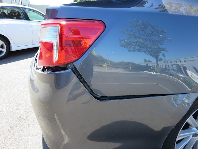 Side view of bumper showing irregular gap due to accident.