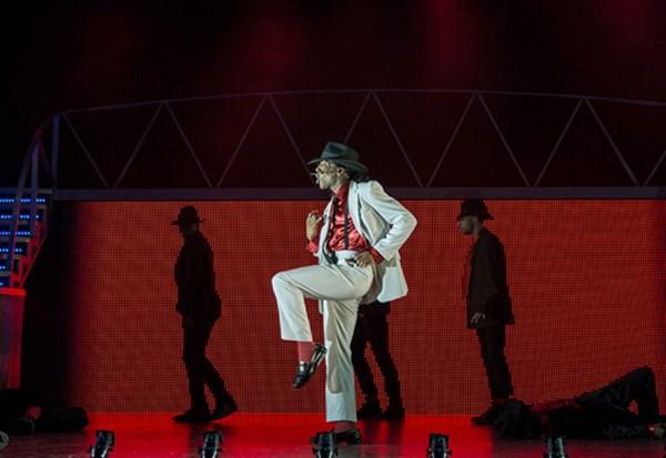 Man on stage dressed as Michael Jackson.