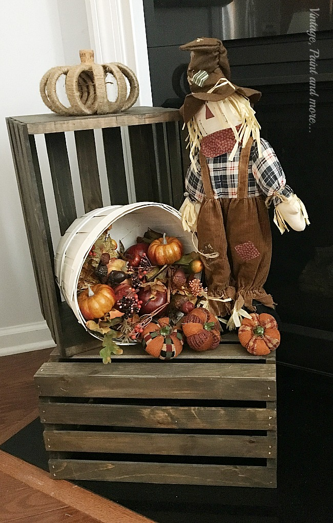 Vintage, Paint and more... stained wood crates with scarecrow, bushel basket of faux fall flowers, fruits and pumpkins and twine wrapped pumpkin