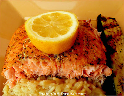Grilled Cedar Planked Salmon, a healthy and flavorful dinner. Lightly marinated, then grilled on a cedar plank. | Recipe developed by www.BakingInATornado.com | #recipe #dinner #fish
