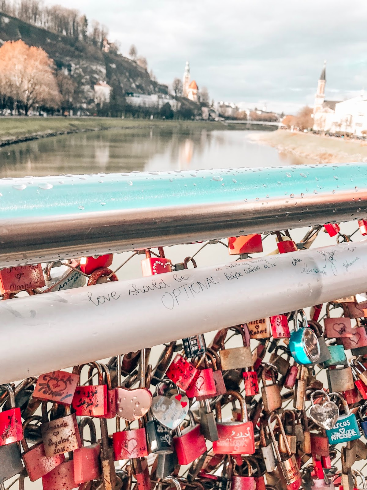 Salzburg river bridge with love locks