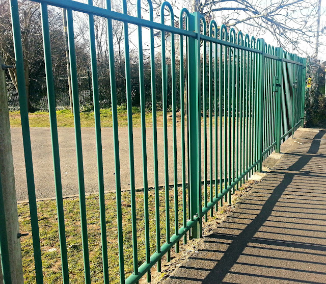 Green school railings