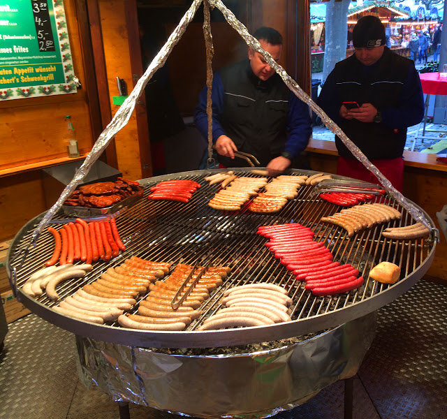 Wurst being grilled at Frankfurt's Christkindlmarkt, Germany