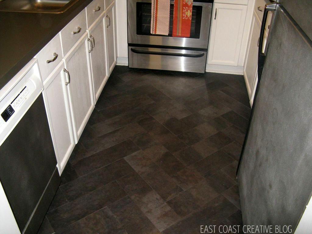 diy herringbone tile floor using peel vinyl flooring for kitchen DIY Herringbone Tile Floor Using Peel Stick Vinyl Knock It Off