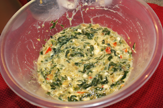 garlic. spinach, and onion mixed with egg in bowl in preparation for Spinach, Feta & Red Pepper Filo Quiche