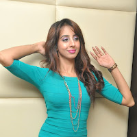 Stylish sanjjana in hot blue dress at tollywood channel press meet