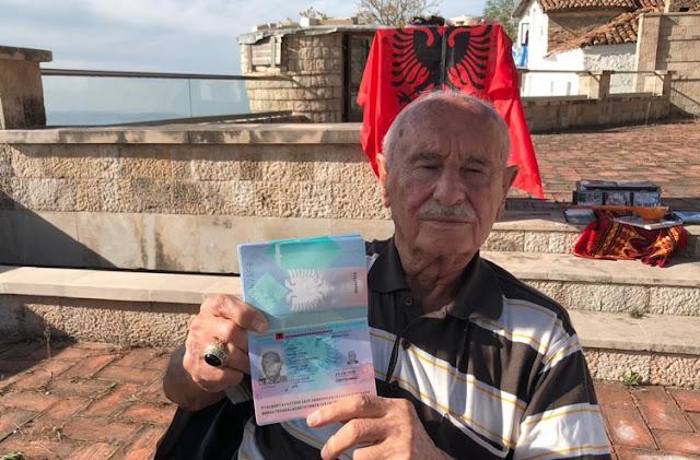 Fikret Tevfik Oktay showing his passport