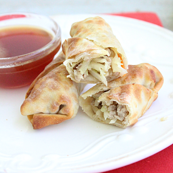 Pork Egg Rolls with Homemade Sweet and Sour Sauce from Table for Seven: Skip take out version and make these simple egg rolls at home!
