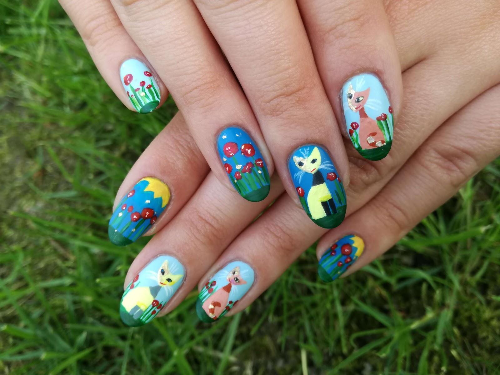 koty na paznokciach ręcznie malowane