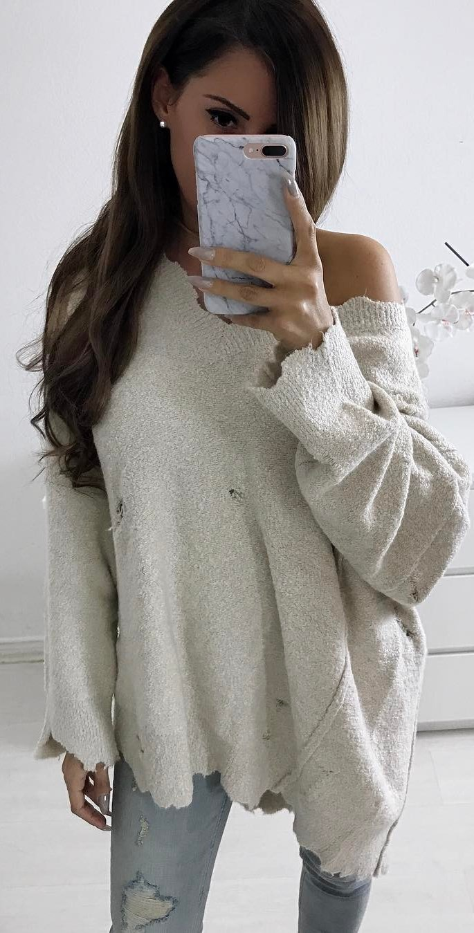 one shoulder sweater and jeans