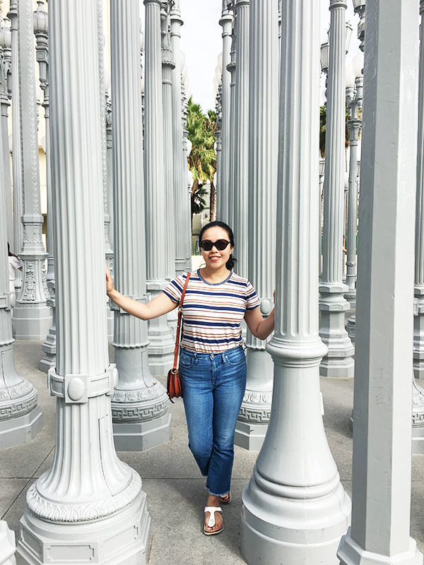 Vancouver beauty and lifestyle blogger Solo Lisa poses with the Urban Light art installation at LACMA.