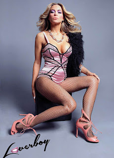 Carmen Electra Sitting On Chair In Lingerie