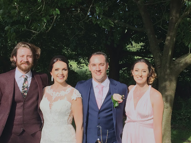 Four friends at a Summer wedding
