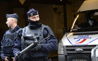 FRENCH POLICE RESTRAIN WOMAN AFTER BOMB THREAT AT HOSPITAL