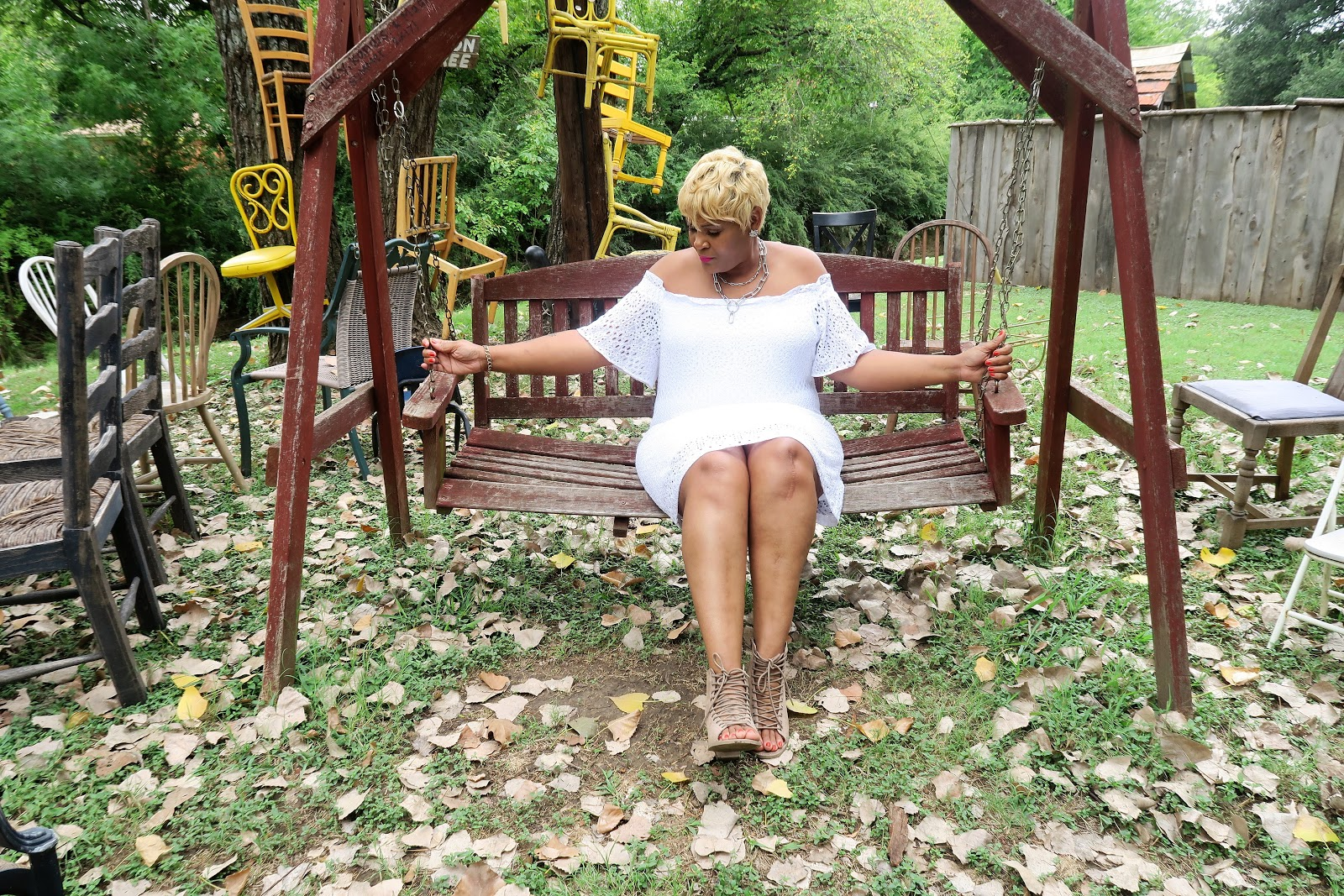 Image: Tangie Bell sitting on a swing in her white dress. Sharing 12 things about getting old. Seen first on Bits and Babbles . Being Forty-Something