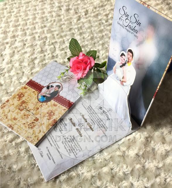 Contoh undangan pernikahan hardcover sin sin dan tasha