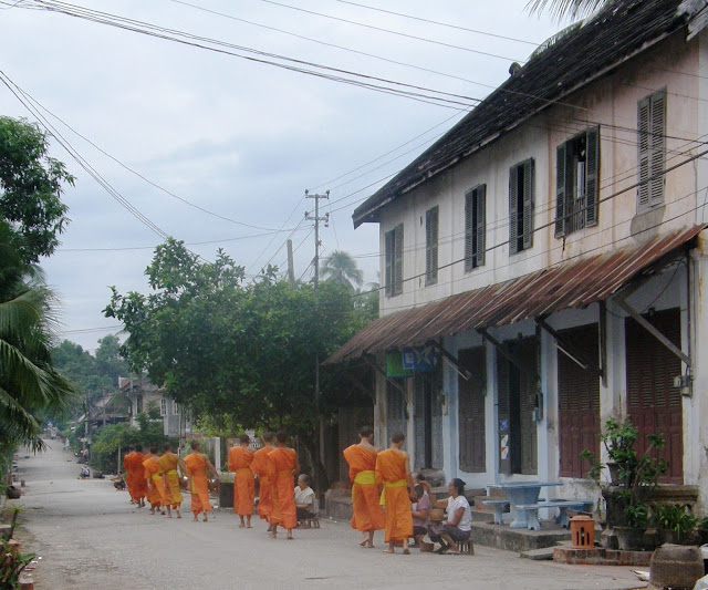 Monks receiving alms in Luang Prabang, Laos