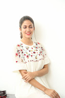 Lavanya Tripathi in Summer Style Spicy Short White Dress at her Interview  Exclusive 110.JPG