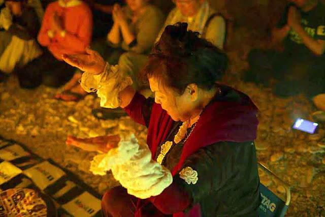 Rituals and prayer in a cave, Ayako Toguchi, priestess