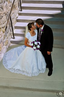 Professional quality wedding portrait photograph looking down at a bride and groom on stairs in Brigham City, Utah by Cramer Imaging