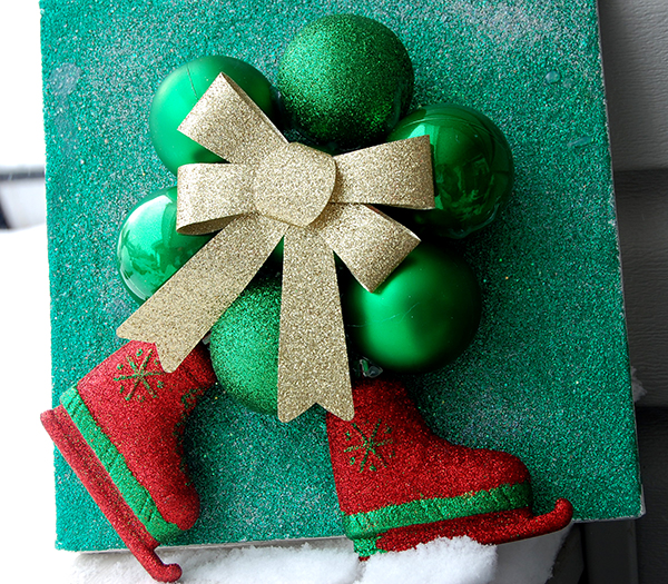 Green glitter canvas, green ornaments, gold ribbon, red and green skates