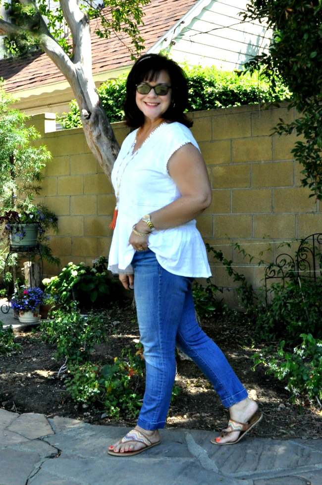 white peplum top and blue cuffed jeans