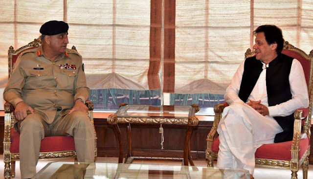 Image Attribute: Pakistan Army's Chief of Army Staff (COAS) General Qamar Javed Bajwa visits meets newly-elected Prime Minister of Pakistan Imran Khan at latter's office on August 27, 2018, / Source: INP