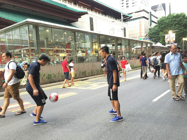 Pedestrian Night on Orchard Road - Playing Soccer 2